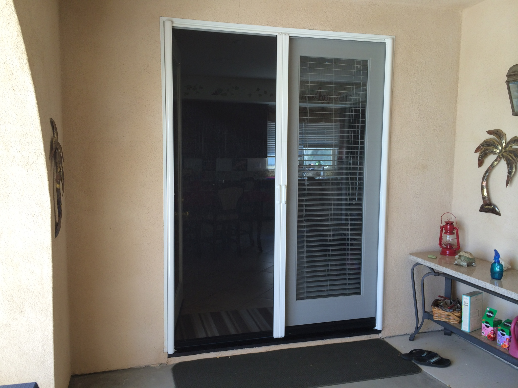 White Mirage French door retractable screen door installed in Corona
