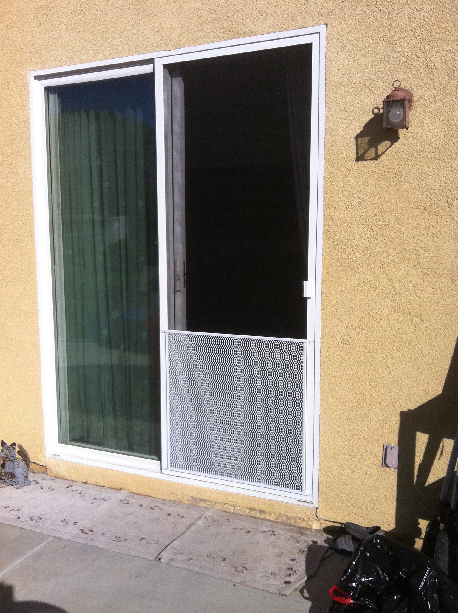 White sliding screen door installed with pet grill. Murrieta 11/8/13