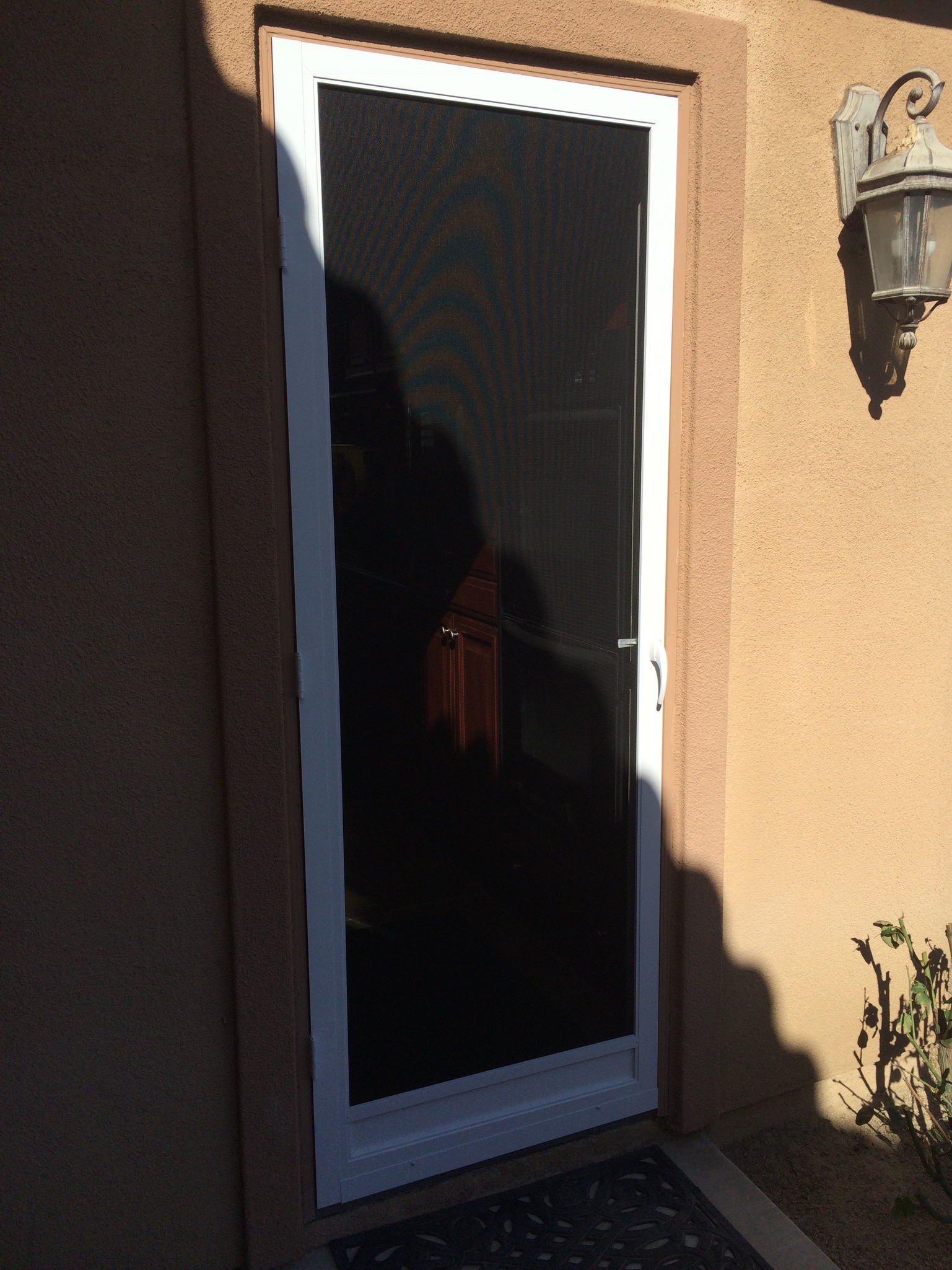 "White ""vista"" swinging screen door installed in Corona 3/10/15"