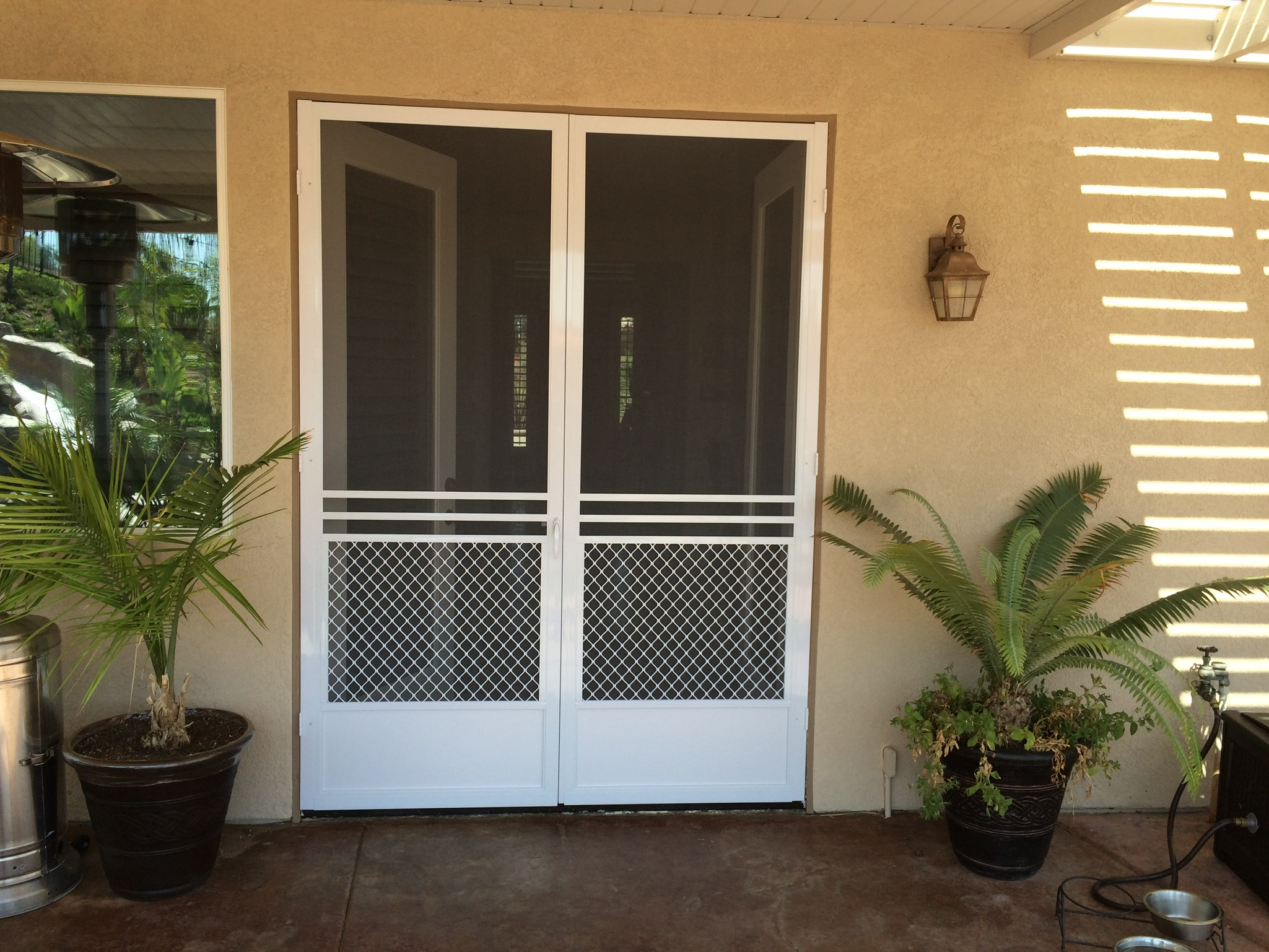 "White ""safeguard"" French door swinging screen doors installed in Corona 9/6/14"