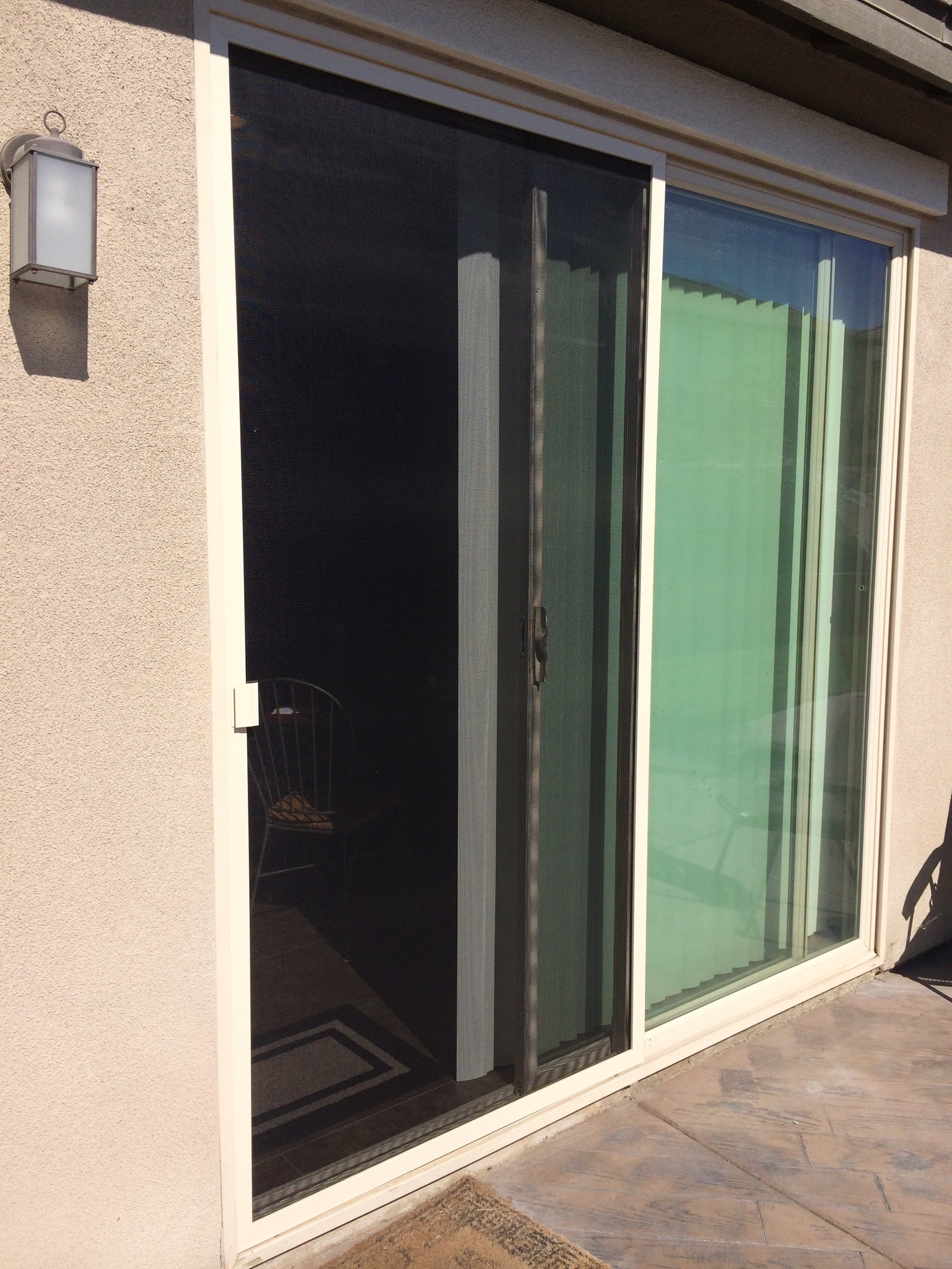 "White 48""x94"" sliding screen door installed in Riverside 7/14/14"