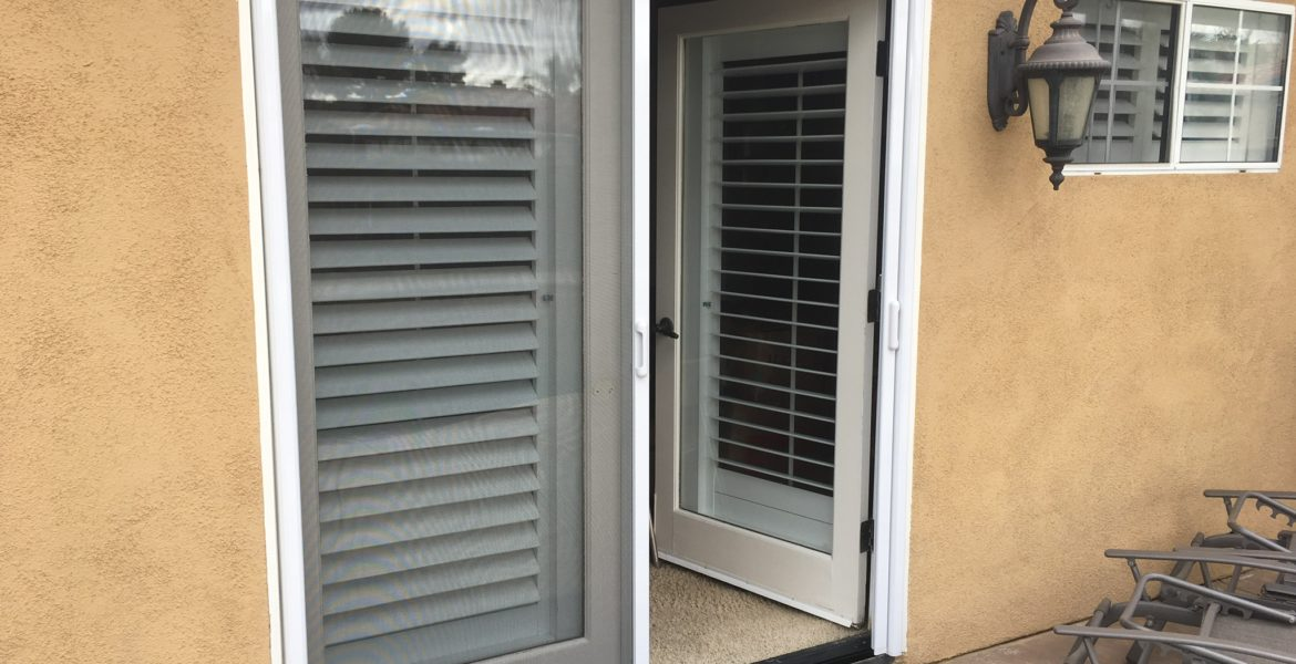 2 white French door Mirage retractable screen doors — Canyon Lake, CA - 2