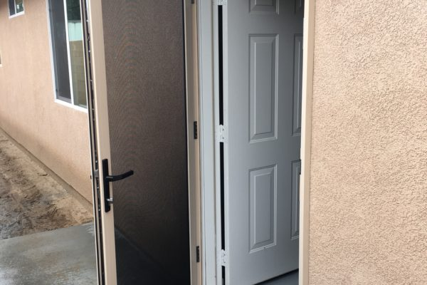 "3'0""x6'8"" almond Guarda security screen door installed on garage door — Riverside, CA - 2"